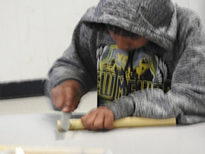 Student Making a Flute