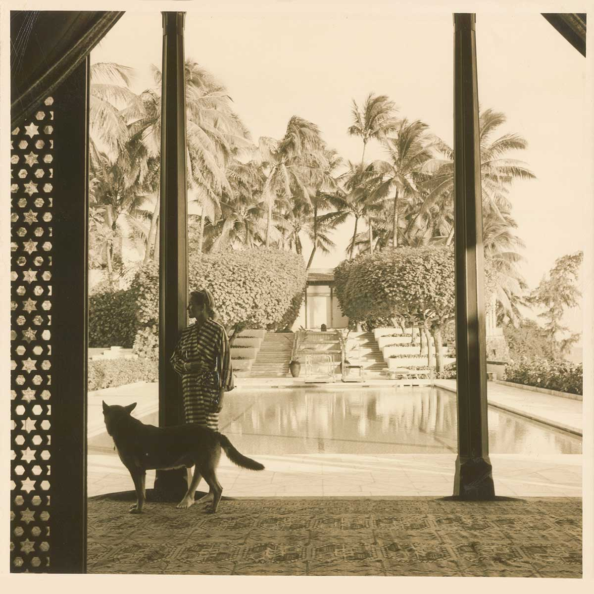 Doris Duke, with dog