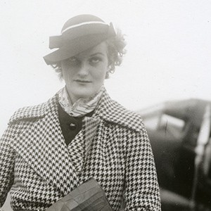 Doris Duke, standing in front of small clipper plane