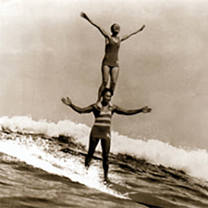 Doris Duke and Sam Kahanamoku Surfing in Hawaii