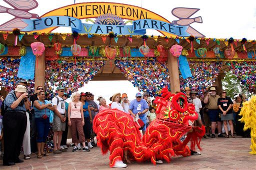 This undated image, provided by the International Folk Art Market, shows Vanh Hanh Vietnamese Lion Dancers entertaining the crowd at the International Folk Art Market in Santa Fe, N.M.