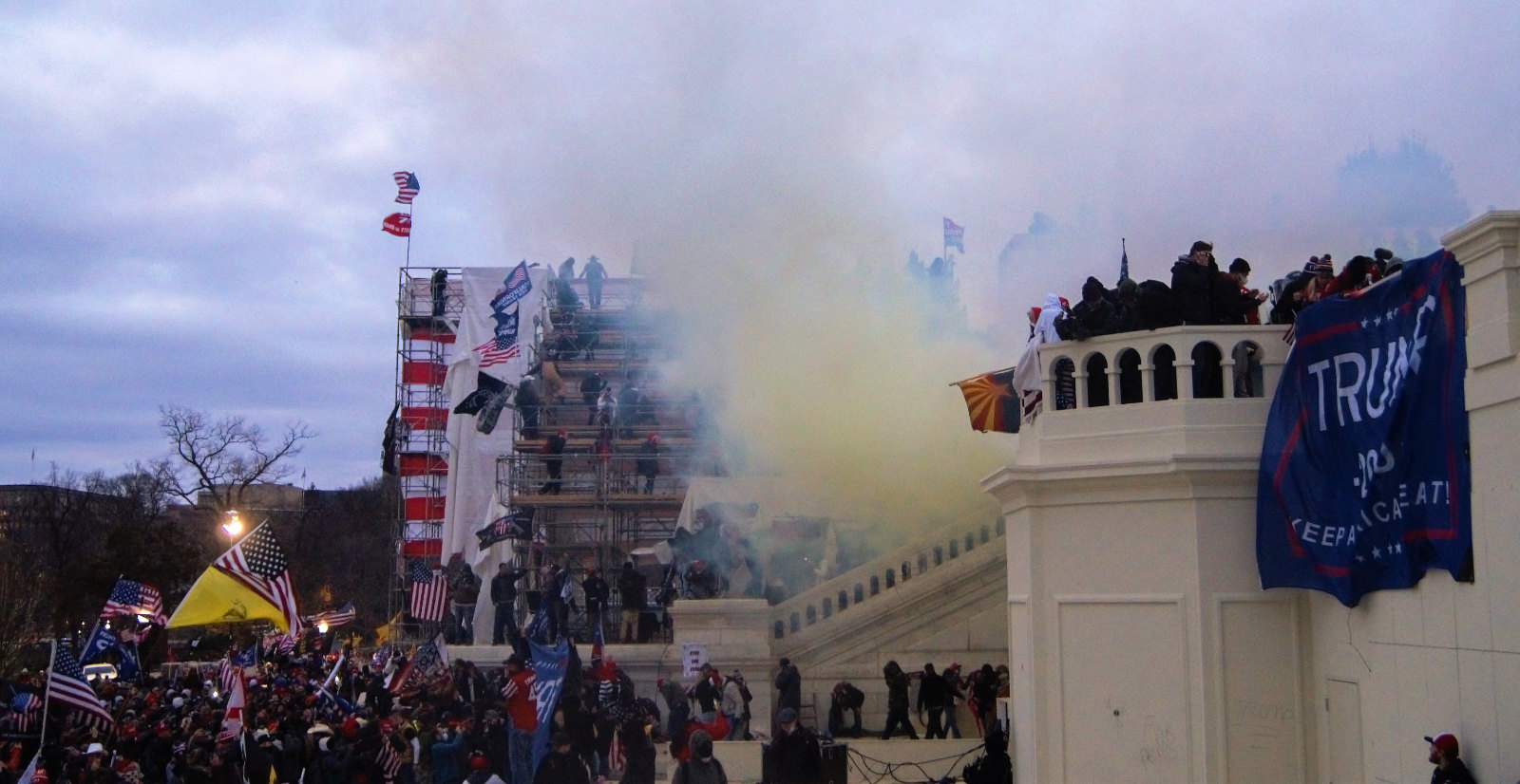 Photo of protestors and tear gas outside United States Capitol