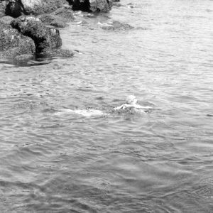 Photo of Doris Duke swimming in the ocean