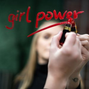 "Photo of writing ""Girl Power"" on a mirror with lipstick"