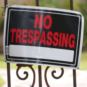 Photo of No Trespassing sign on gate